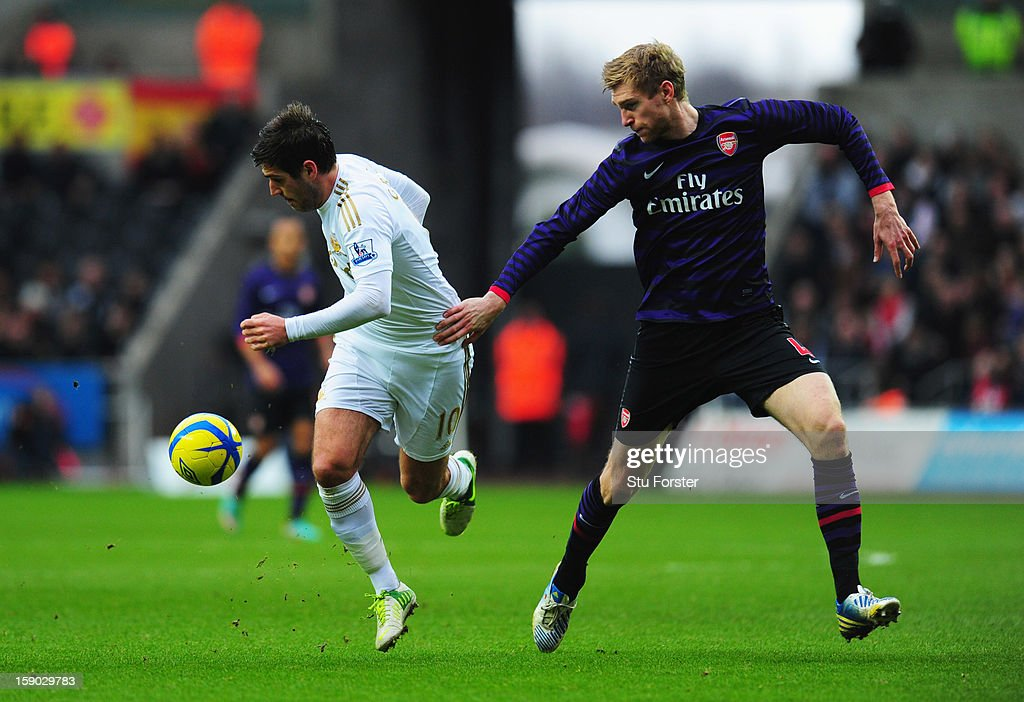 Danny Graham of Swansea City holds off Per Mertesacker of Arsenal during the FA Cup with Budweiser Third Round match between Swansea City and Arsenal at Liberty Stadium on January 6, 2013 in Swansea, Wales.
