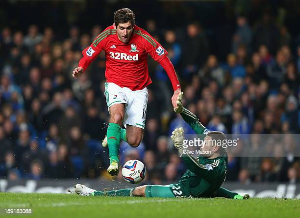 Danny Graham of Swansea City rounds goalkeeper Ross Turnbull of Chelsea on the way to scoring during the Capital One Cup SemiFinal first leg match...