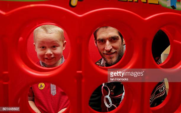 Danny Graham plays connect four with Jack Wilson on the children wards at Durham University Hospital on December 15 2015 in Sunderland England