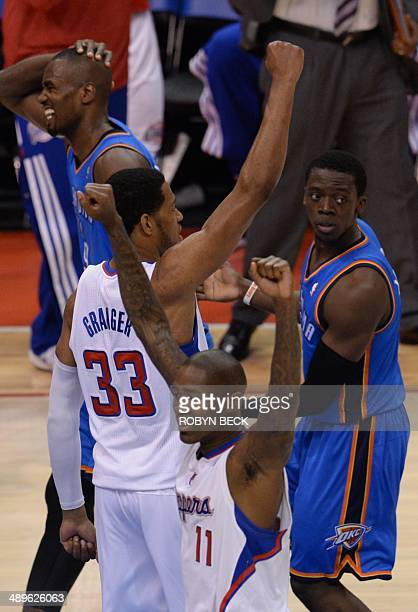 Danny Granger and Jamal Crawford of the Los Angeles Clippers celebrate their 101 99 victory before members of the Oklahoma City Thunder in Game 4 of...
