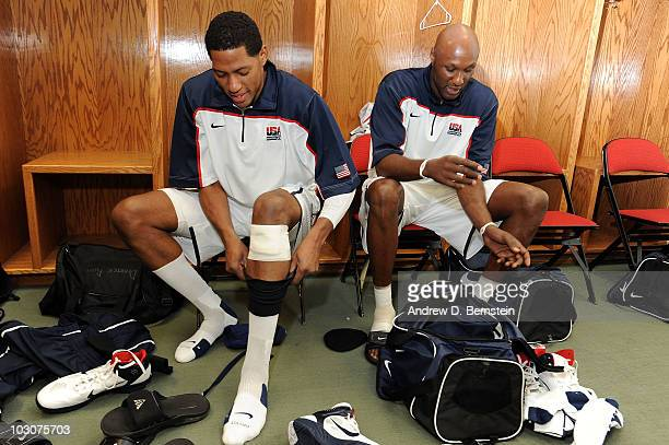 Danny Granger and Lamar Odom of the 2010 USA Basketball Men's National Team get dressed in the locker room before the USA Basketball Showcase at the...