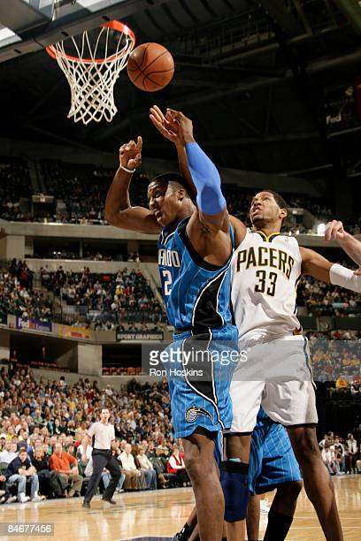 Danny Granger of the Indiana Pacers battles for the ball with Dwight Howard of the Orlando Magic at Conseco Fieldhouse on February 6, 2009 in...