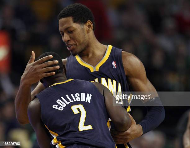 Danny Granger of the Indiana Pacers congratulates Darren Collison after Collison shot a 3point shot late in the fourth quarter against the Boston...