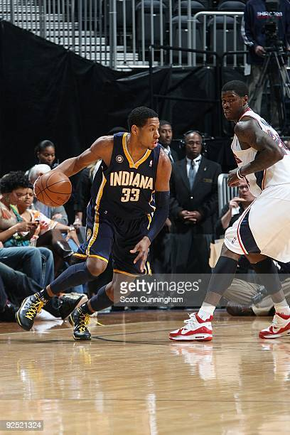 Danny Granger of the Indiana Pacers drives the ball against Marvin Williams of the Atlanta Hawks during the game on October 28 2009 at Philips Arena...