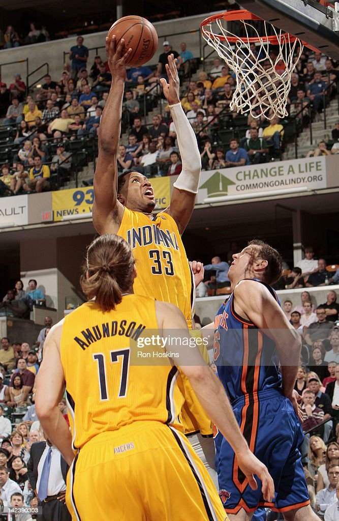Danny Granger #33 of the Indiana Pacers goes to the basket against Josh Harrellson #55 of the New York Knicks during the game on April 3, 2012 at Bankers Life Fieldhouse in Indianapolis, Indiana.