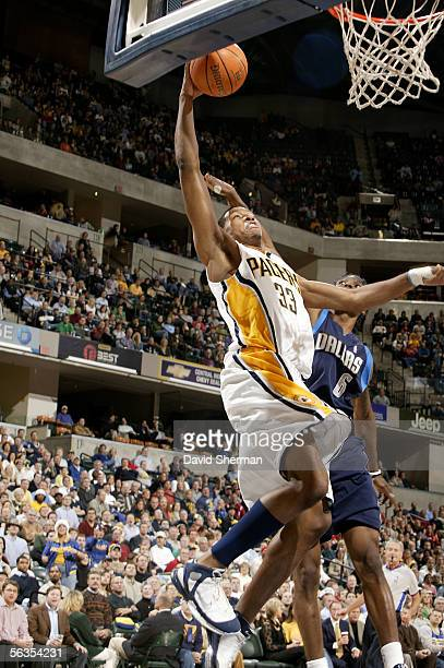 Danny Granger of the Indiana Pacers goes to the basket against Marquis Daniels of the Dallas Mavericks on December 6 2005 at Conseco Fieldhouse in...
