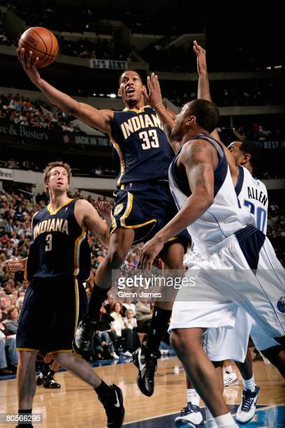 Danny Granger of the Indiana Pacers goes up for a shot over Malik Allen and Antoine Wright of the Dallas Mavericks during the game on March 14 2008...