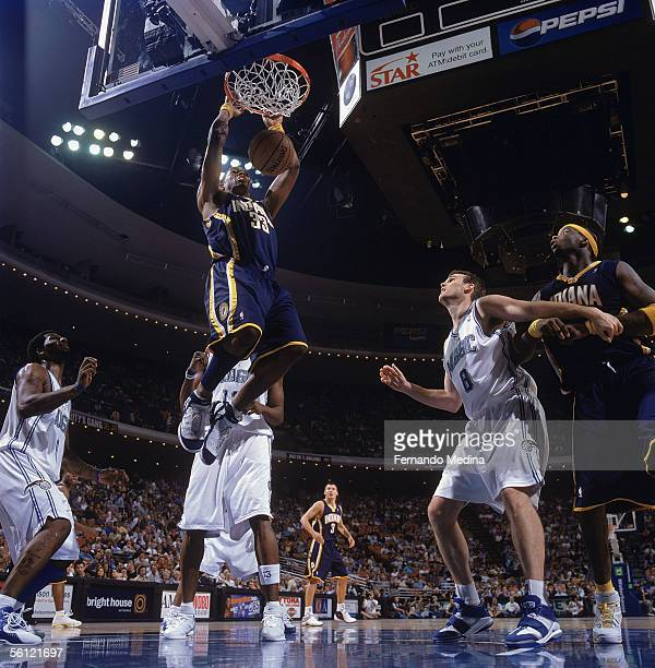 Danny Granger of the Indiana Pacers makes the dunk against the Orlando Magic at the TD Waterhouse Centre on November 2 2005 in Orlando Florida The...