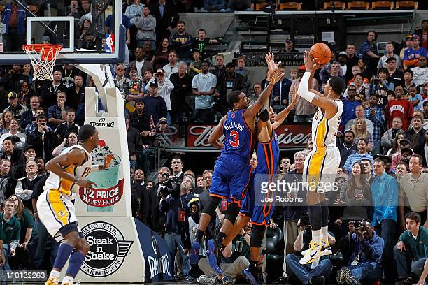 Danny Granger of the Indiana Pacers takes the gamewinning shot over Shawne Williams and Jared Jeffries of the New York Knicks on March 15 2011 at...