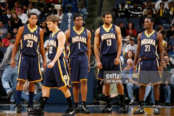 Danny Granger, Travis Diener, Ike Diogu, David Harrison and Kareen Rush of the Indiana Pacers stand on the court during the game against the Memphis...