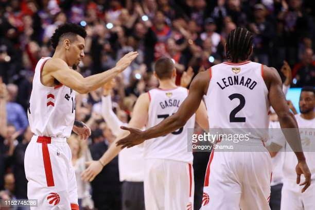 Danny Green and Kawhi Leonard of the Toronto Raptors celebrate the play against the Golden State Warriors in the second half during Game One of the...