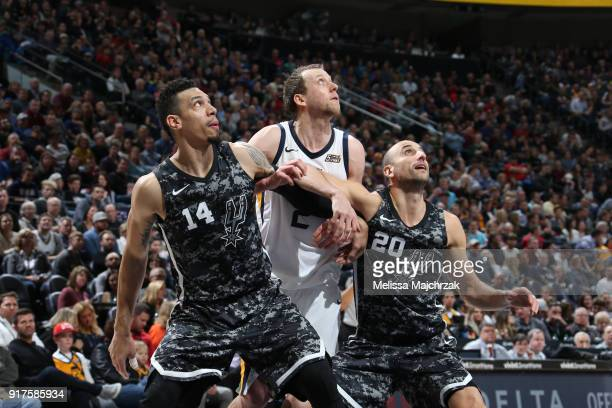 Danny Green and Manu Ginobili of the San Antonio Spurs box out against Joe Ingles of the Utah Jazz on February 12 2018 at vivintSmartHome Arena in...
