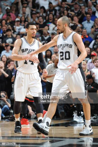 Danny Green and Manu Ginobili of the San Antonio Spurs high five during the game against the Houston Rockets in Game Five of the Western Conference...