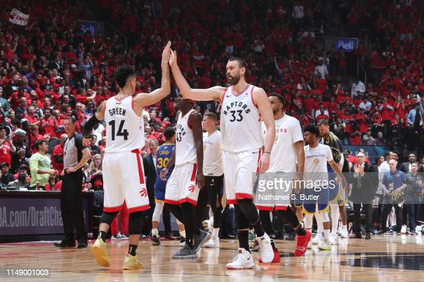 Danny Green and Marc Gasol of the Toronto Raptors high five against the Golden State Warriors during Game Five of the NBA Finals on June 10 2019 at...