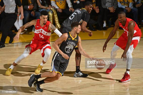 Danny Green and Serge Ibaka of the Toronto Raptors guard Klay Thompson of the Golden State Warriors during Game Four of the NBA Finals on June 7 2019...
