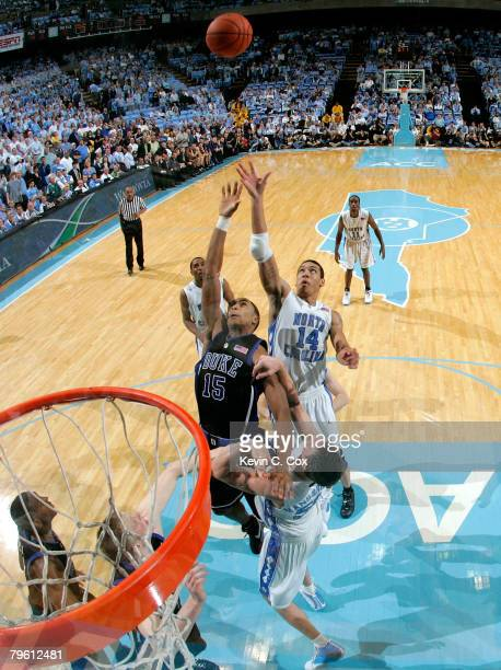 Danny Green and Tyler Hansbrough of the North Carolina Tar Heels battle for a rebound against Gerald Henderson of the Duke Blue Devils during the...