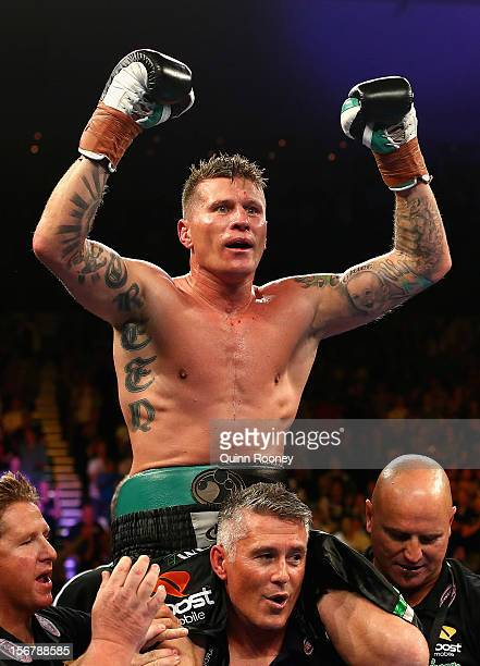 Danny Green of Australia celebrates winning the world title bout between Danny Green of Australia and Shane Cameron of New Zealand at Hisense Arena...