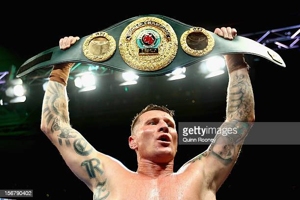 Danny Green of Australia celebrates with the belt after winning the world title bout between Danny Green of Australia and Shane Cameron of New...