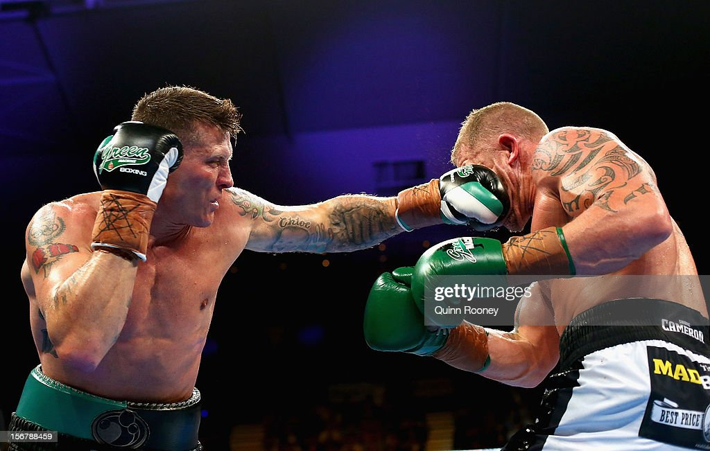 Danny Green of Australia lands a punch to Shane Cameron of New Zealand during their world title bout at Hisense Arena on November 21, 2012 in Melbourne, Australia.