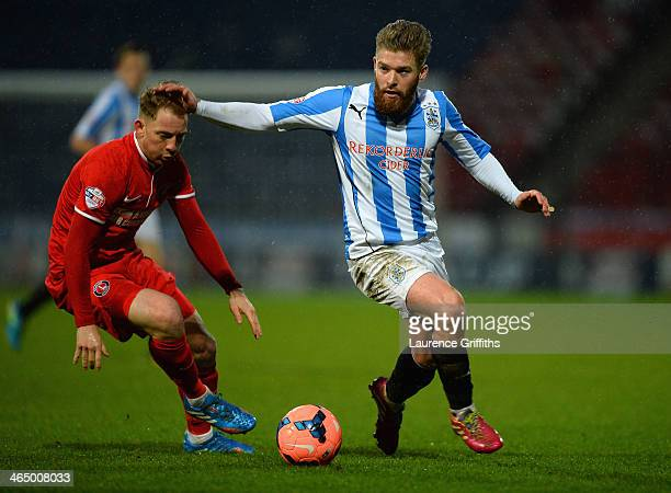Danny Green of Charlton Athletic battles with Dale Stephens of Huddersfield during the Budweiser FA Cup Fourth Round match between Huddersfield Town...