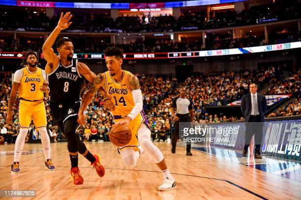 Danny Green of Los Angeles Lakers is guarded by Spencer Dinwiddie of the Brooklyn Nets during their National Basketball Association preseason match...