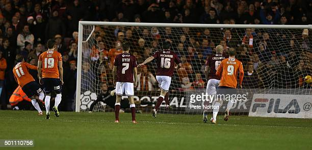Danny Green of Luton Town scores his sides third goal from the penalty spot during the Sky Bet League Two match between Luton Town and Northampton...