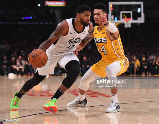 Danny Green of the Los Angeles Lakers defends Paul George of the Los Angeles Clippers as he drives to the basket in the first half of the game at...