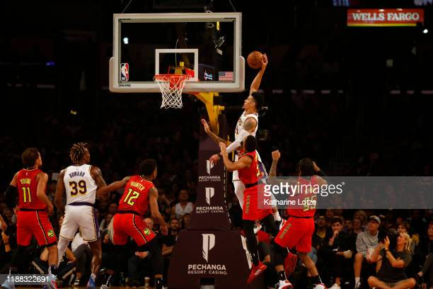 Danny Green of the Los Angeles Lakers dunks the ball as Allen Crabbe of the Atlanta Hawks defends during the first half of a game at Staples Center...