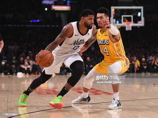 Danny Green of the Los Angeles Lakers guards Paul George of the Los Angeles Clippers as he drives to the basket in the game at Staples Center on...