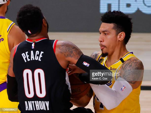 Danny Green of the Los Angeles Lakers strips the ball from Carmelo Anthony of the Portland Trail Blazers and scores during the third quarter in Game...