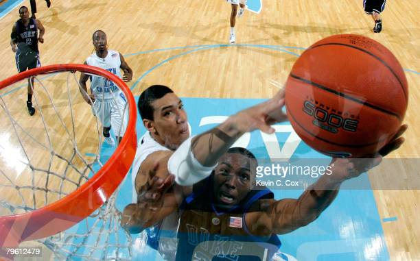 Danny Green of the North Carolina Tar Heels blocks a layup by DeMarcus Nelson of the Duke Blue Devils during the second half at the Dean E Smith...
