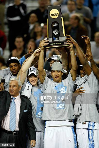Danny Green of the North Carolina Tar Heels celebrates with the championship trophy after defeating the Michigan State Spartans 8972 during the 2009...