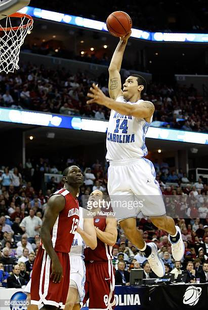 Danny Green of the North Carolina Tar Heels goes up to dunk the ball as Willie Warren of the Oklahoma Sooners looks up in the second half during the...
