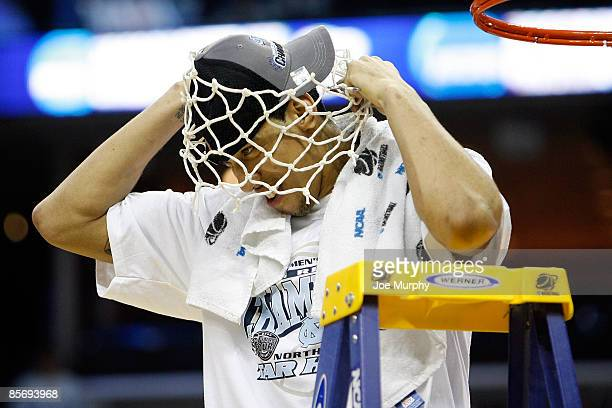 Danny Green of the North Carolina Tar Heels puts the net over his head after defeating the Oklahoma Sooners during the NCAA Men's Basketball...