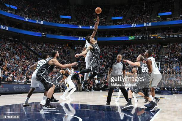 Danny Green of the San Antonio Spurs and Derrick Favors of the Utah Jazz jump for possession on February 12 2018 at vivintSmartHome Arena in Salt...