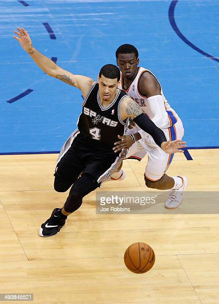 Danny Green of the San Antonio Spurs and Reggie Jackson of the Oklahoma City Thunder go for a loose ball in the second half during Game Three of the...