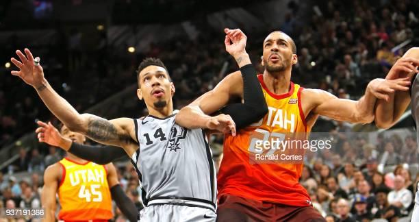 Danny Green of the San Antonio Spurs battles Rudy Gobert of the Utah jazz for rebounding position at ATT Center on March 23 2018 in San Antonio Texas...