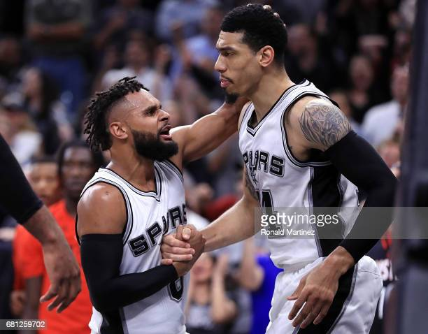 Danny Green of the San Antonio Spurs celebrates with Patty Mills after a foul in overtime against the Houston Rockets during Game Five of the Western...