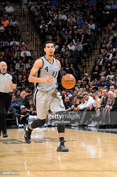 Danny Green of the San Antonio Spurs controls the ball against the Houston Rockets at the ATT Center on November 30 2013 in San Antonio Texas NOTE TO...