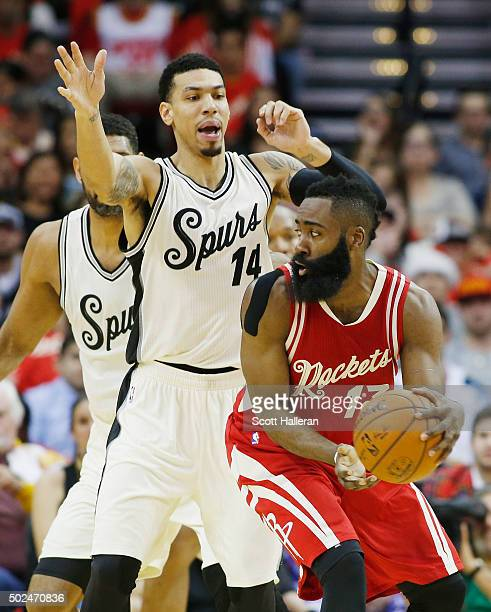 Danny Green of the San Antonio Spurs defends against James Harden of the Houston Rockets during their game at the Toyota Center on December 25 2015...