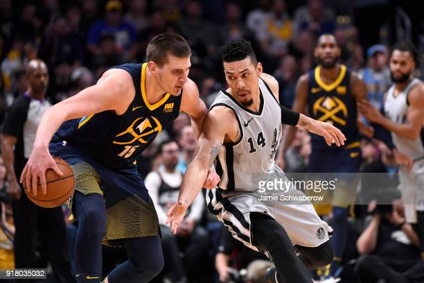Danny Green of the San Antonio Spurs defends Nikola Jokic of the Denver Nuggets at Pepsi Center on February 13 2018 in Denver Colorado NOTE TO USER...