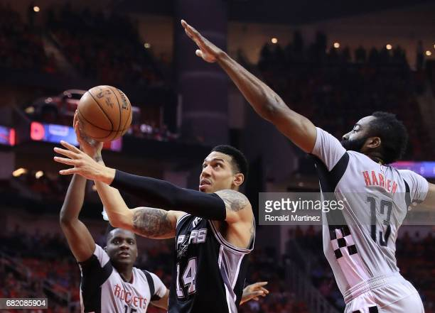 Danny Green of the San Antonio Spurs drives between James Harden and Clint Capela of the Houston Rockets during Game Six of the NBA Western...