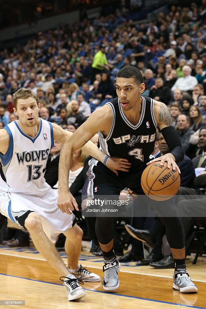 Danny Green #4 of the San Antonio Spurs drives to the basket against the Minnesota Timberwolves on February 6, 2013 at Target Center in Minneapolis, Minnesota.