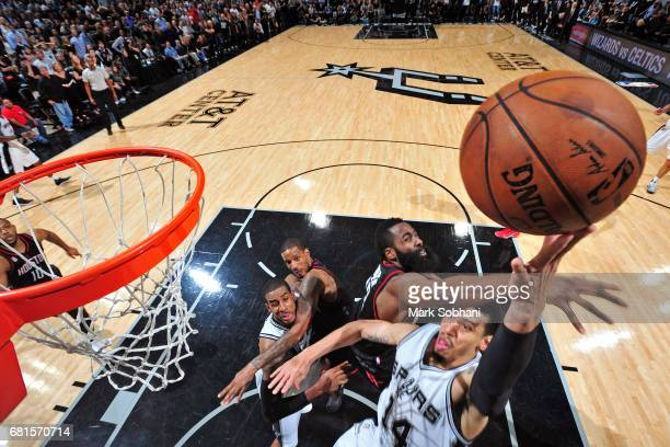 Danny Green of the San Antonio Spurs drives to the basket and shoots the ball against the Houston Rockets in Game Five of the Western Conference...