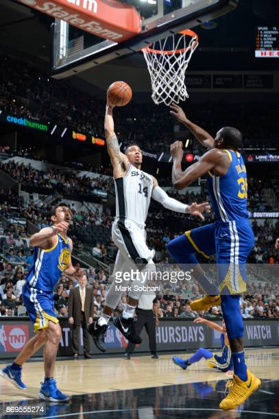 Danny Green of the San Antonio Spurs dunks against Kevin Durant of the Golden State Warriors on November 2 2017 at the ATT Center in San Antonio...