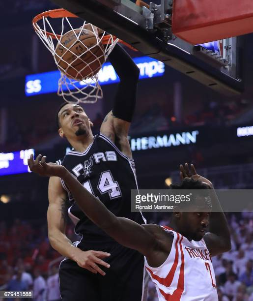 Danny Green of the San Antonio Spurs dunks against Patrick Beverley of the Houston Rockets during Game Three of the NBA Western Conference...