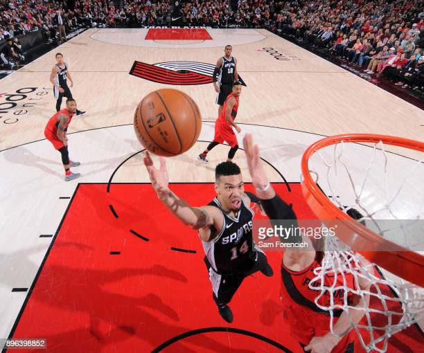 Danny Green of the San Antonio Spurs goes to the basket against the Portland Trail Blazers on December 20 2017 at the Moda Center in Portland Oregon...