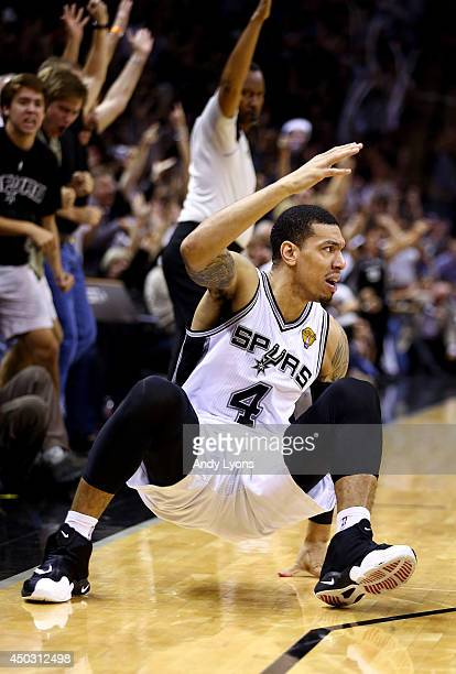 Danny Green of the San Antonio Spurs reacts after hitting a shot against the Miami Heat during Game Two of the 2014 NBA Finals at the ATT Center on...