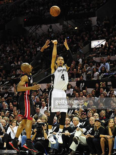 Danny Green of the San Antonio Spurs shoots a threepointer under pressure from Ray Allen of the Miami Heat during game 5 of the NBA finals on June 16...