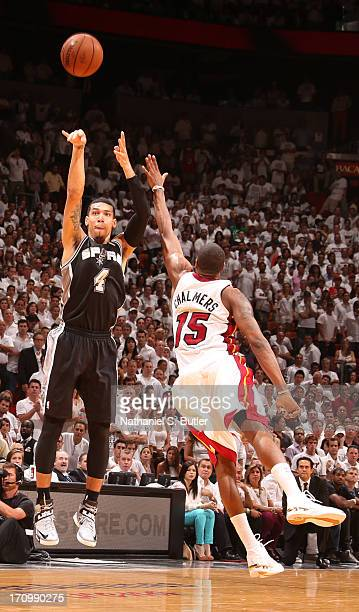 Danny Green of the San Antonio Spurs shoots against Mario Chalmers of the Miami Heat during Game Seven of the 2013 NBA Finals on June 20 2013 at...